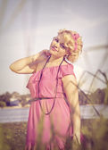 Beautiful pinup girl in pink dress — Stock Photo