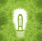 Light bulb made of green grass — Stock Photo