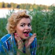 Attractive surprised pin up girl - Stock Photo