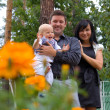 Стоковое фото: Happy young family spending time outdoors