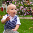 Little boy clapping in the park — Stock Photo #13262545