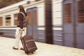 Walking passenger on a train station — Stockfoto
