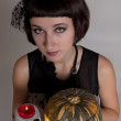 Cute girl - witch with skull and a pumpkin — Stock Photo