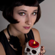 Witch with a skull in a black cylinder hat — Stock Photo #13594311
