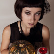 Pretty girl - witch with skull and a pumpkin — Stock Photo