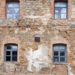 Old orange brick wall with four windows — Stock Photo