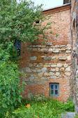 Small window in the brick wall — Stock Photo