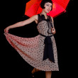 Woman in retro styled dress with red umbrella — Stock Photo