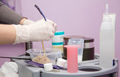 Hairdresser preparing peroxide for hair dyeing treatment — Stock Photo