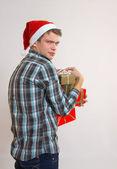Greedy young man - Santa Claus — Stock Photo