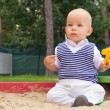 Toddler playing in the sand — Stock Photo
