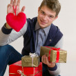 Teenager with heart and gifts — Stock Photo