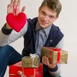 Teenager with heart and gifts — Stock Photo #18901003