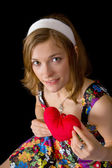 Beautiful girl holding toy heart — Stock Photo