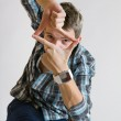 Young the man looking through a frame of fingers — Stock Photo