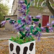 Tree with flowers made from plastic bottles - Stock Photo