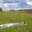 Man lying on a spring meadow — Stock Photo