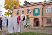 Laundry hanging out in old yard — Stock Photo