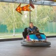 Senior man in small car at amusement park — Stock Photo #23646189