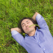 Business man lying on grass — Stock Photo #23646289