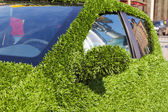 Close up of eco green grass car — Стоковое фото