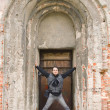 Man standing in old arched door — Stock Photo