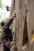 Rock climber climbing up — Stock Photo