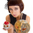 Womwith skull and pumpkin — Stock Photo #29595823