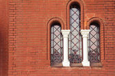 An antique window in church — Stock Photo