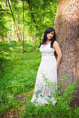 Romantic woman in summer forest — Stock Photo