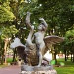 Boy and swan statue in park, Minsk. Belarus. — Stock Photo