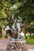Boy and swan statue in park, Minsk. Belarus. — Stock Photo