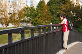 Young man walking on bridge — Stock Photo