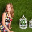 Beautiful blond woman in studio grass background — Stock Photo