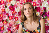 Pretty woman over Floral Background — Stockfoto