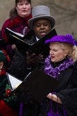 Holiday carolers — Stock Photo