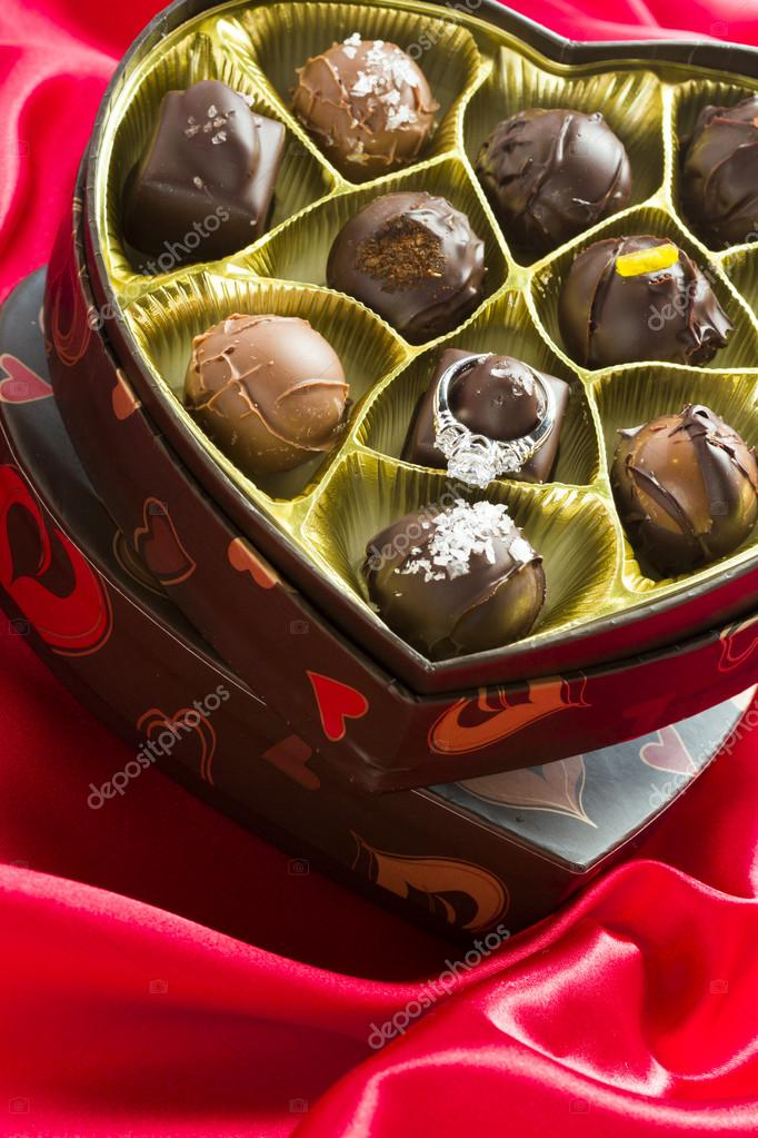 Fancy truffles in heart shaped boxes for Valentin's Day. — Stock fotografie #18911669