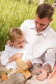 Father and son at Family summer picnic — Stock Photo