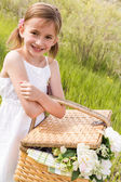 Cute girl with picnic basket — Stock Photo