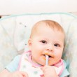 Baby girl in high chair — Stock Photo #48307809