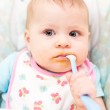 Baby girl in high chair — Stock Photo #48307817
