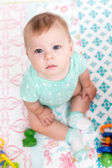 Cute baby girl with toys — Stock Photo
