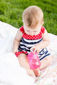 Cute baby girl with her bottle — Stock Photo