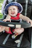 Baby girl in her stroller. — Stock Photo