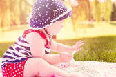 Cute baby girl in park — Stock Photo