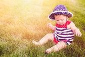 Cute baby girl in park — Stock Photo