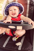 Baby girl in her stroller. — Stock Photo