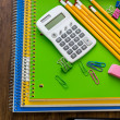 School supplies, pencils, toy school bus, note book, calculator — Stock Photo #51385809