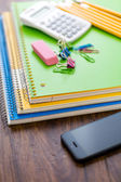 School supplies, pencils, note book, calculator — Stock Photo