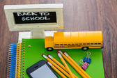 School supplies, pencils, note book, cell phone — Stock Photo